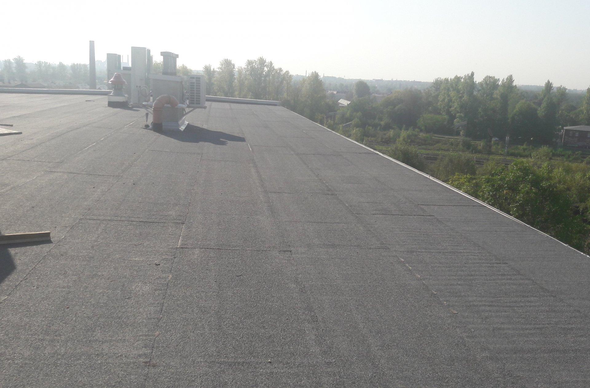 Naprawy miejscowe dachu papowego,